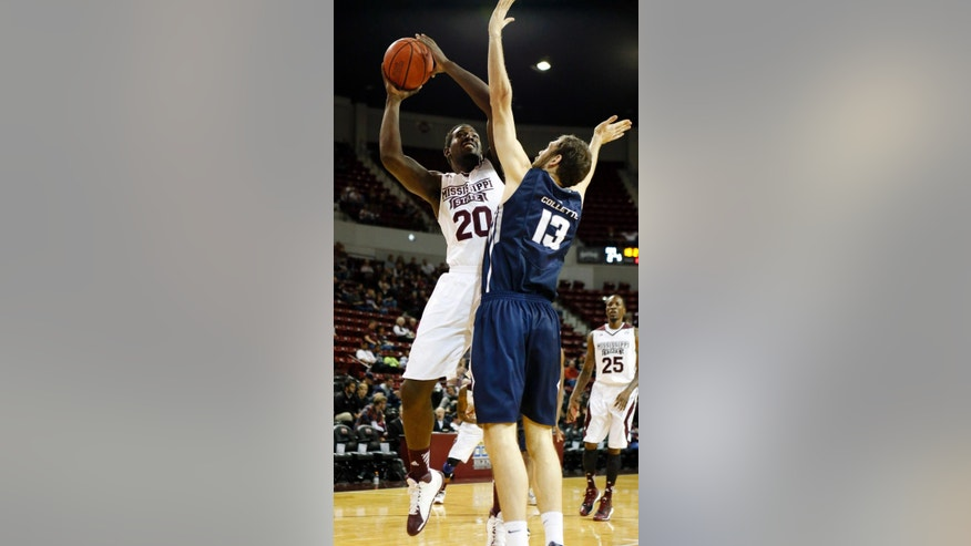 Mississippi State forward Gavin Ware (20) attempts a basket over the defense of Utah State forward David Collette (13) in the first half of an NCAA college basketball game Saturday, Nov. 22, 2014, in Starkville, Miss. (AP Photo/Rogelio V. Solis)