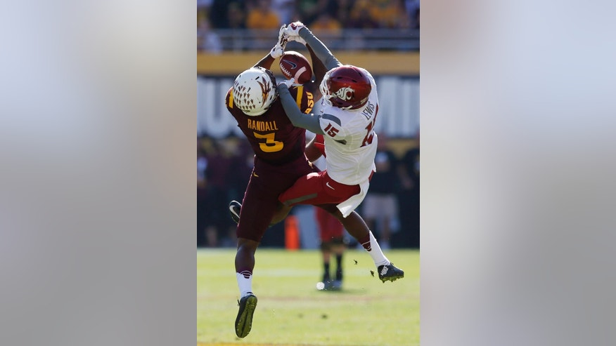Arizona State's Damarious Randall (3) intercepts a pass intended for Washington State's Robert Lewis (15) during the first half of an NCAA college football game, Saturday, Nov. 22, 2014, in Tempe, Ariz. (AP Photo/Ross D. Franklin)
