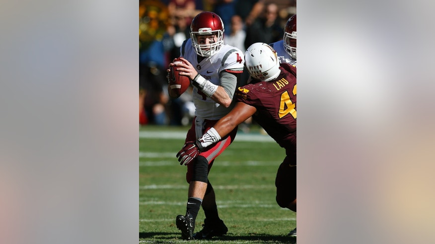 Arizona State's Viliami Latu, right, sacks Washington State's Luke Falk (4) during the first half of an NCAA college football game, Saturday, Nov. 22, 2014, in Tempe, Ariz. (AP Photo/Ross D. Franklin)