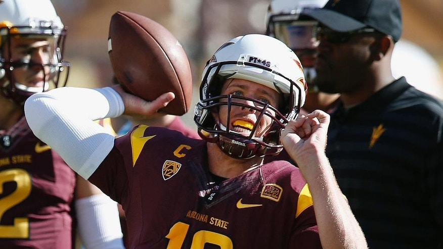 Arizona State's Taylor Kelly throws a pass as he warms up prior to an NCAA college football game agianst Washington State, Saturday, Nov. 22, 2014, in Tempe, Ariz. (AP Photo/Ross D. Franklin)