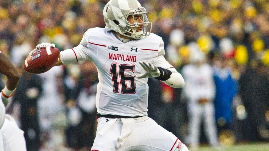 Maryland quarterback C.J. Brown (16) throws a pass in the first quarter of an NCAA college football game against Michigan in Ann Arbor, Mich., Saturday, Nov. 22, 2014. (AP Photo/Tony Ding)