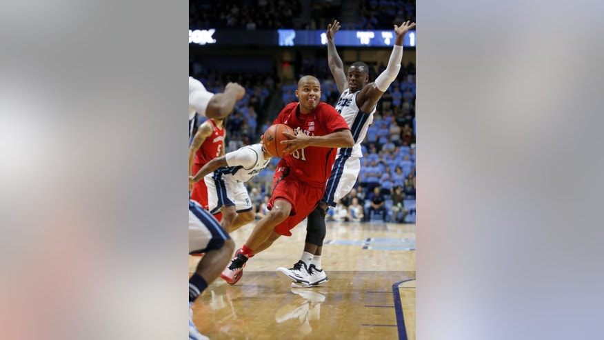 Nebraska's Shavon Shields (31) drives past Rhode Island's Jared Terrell (32) during the first half of an NCAA college basketball game Saturday, Nov. 22, 2014, in Kingston, R.I. (AP Photo/Joe Giblin)