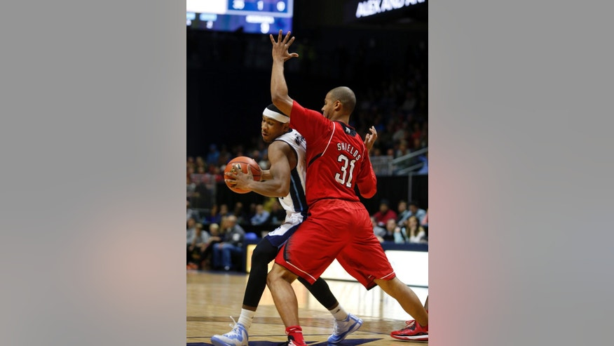 Rhode Island's E.C. Matthews, left, attempts to get around Nebraska's Shavon Shields (31) during the first half an NCAA college basketball game Saturday, Nov. 22, 2014, in Kingston, R.I. (AP Photo/Joe Giblin)