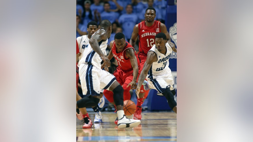 Nebraska's Shavon Shields (31) and Rhode Island's Biggie Minnis (10) reach for a loose ball during the first half of an NCAA college basketball game Saturday, Nov. 22, 2014, in Kingston, R.I. (AP Photo/Joe Giblin)