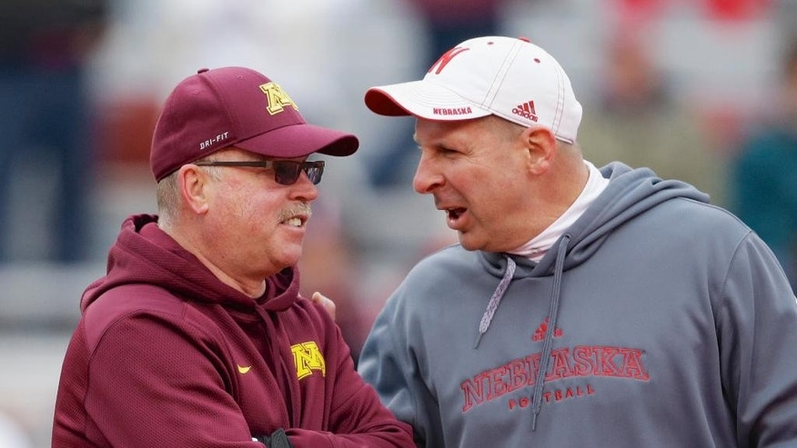 Nebraska head coach Bo Pelini, right, chats with Minnesota head coach Jerry Kill before an NCAA college football game in Lincoln, Neb., Saturday, Nov. 22, 2014. (AP Photo/Nati Harnik)