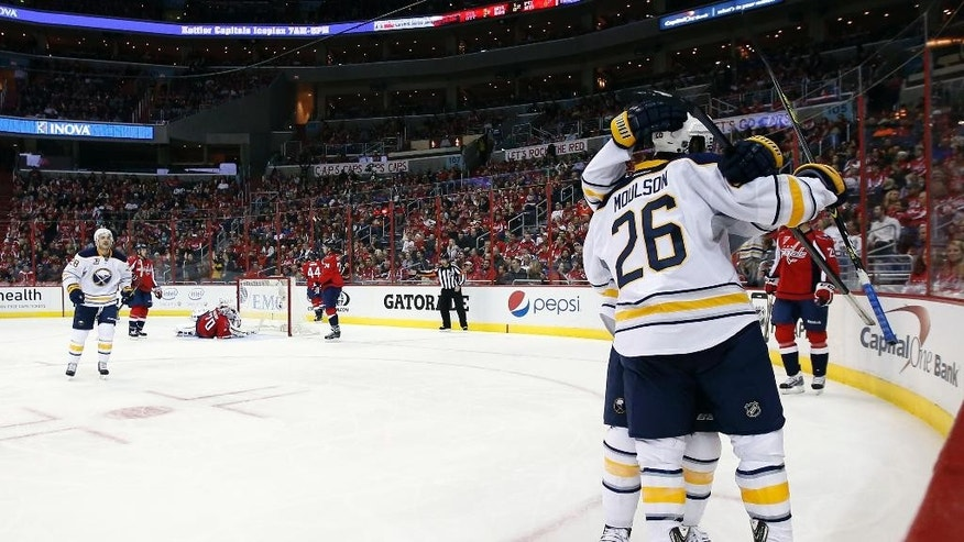 Buffalo Sabres left wing Matt Moulson (26) celebrates his goal with left wing Tyler Ennis (63) in the second period of an NHL hockey game against the Washington Capitals, Saturday, Nov. 22, 2014, in Washington. (AP Photo/Alex Brandon)