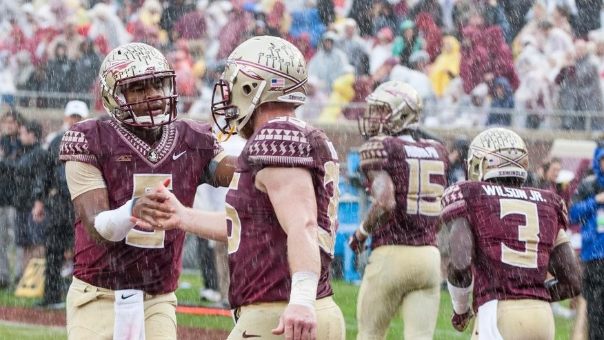 Florida State quarterback Jameis Winston, left, congratulates Nick O'Leary on a touchdown during the first half of an NCAA college football game against Boston College in Tallahassee, Fla., Saturday, Nov. 22, 2014.  (AP Photo/Mark Wallheiser)