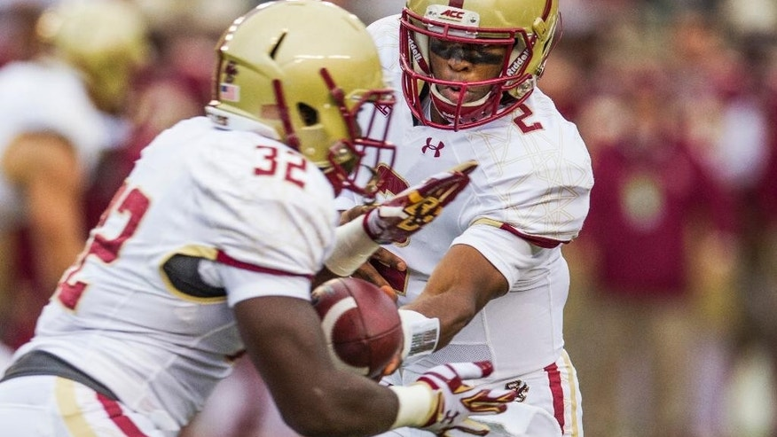 Boston College quarterback Tyler Murphy, right, hands off to running back Jon Hilliman during the first half of an NCAA college football game against Florida State in Tallahassee, Fla., Saturday, Nov. 22, 2014.  (AP Photo/Mark Wallheiser)