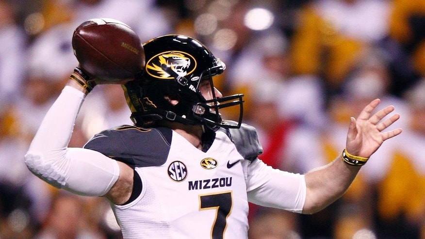 Missouri quarterback Maty Mauk throws to a receiver in the first half of an NCAA college football game against Tennessee, Saturday, Nov. 22, 2014, in Knoxville, Tenn. (AP Photo/Wade Payne)