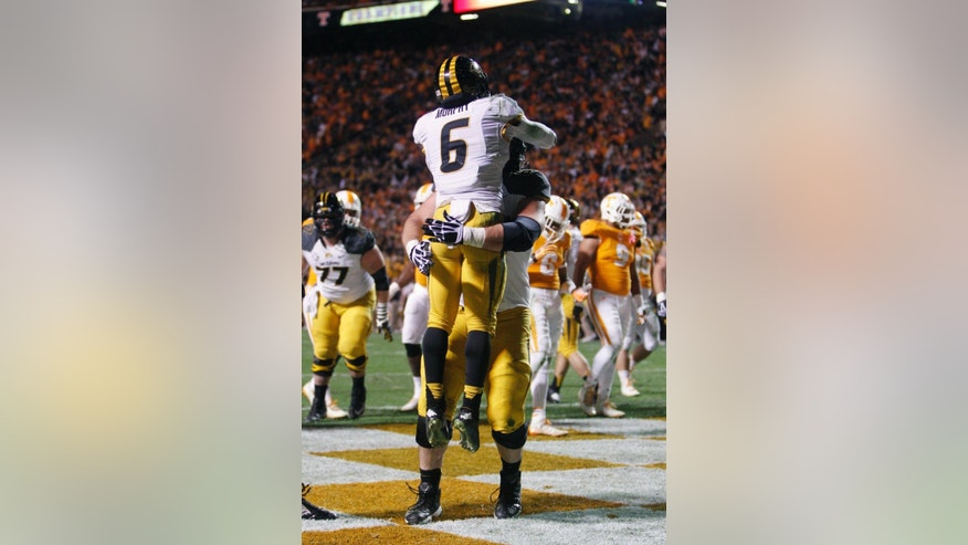Missouri tailback Marcus Murphy (6) celebrates with offensive lineman Taylor Chappell after scoring a touchdown in the first half of an NCAA college football game Saturday, Nov. 22, 2014, in Knoxville, Tenn. (AP Photo/Wade Payne)