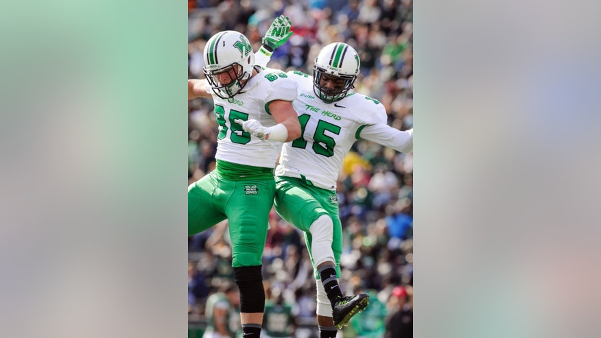 Marshall wide receiver Angelo Jean-Louis (15) and tight end Joe Woodrum (89) celebrate a touchdown against UAB during the second quarter of an NCAA college football game, Saturday, Nov. 22, 2014, in Birmingham, Ala. (AP Photo/John Amis)