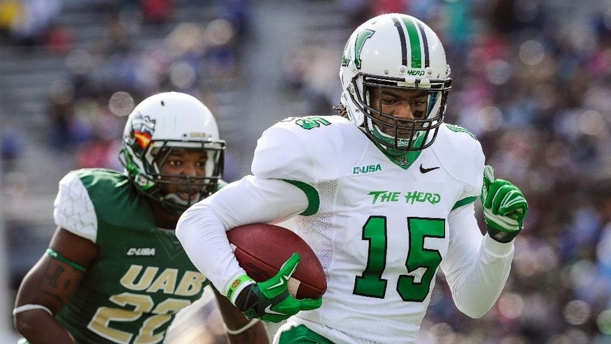 Marshall wide receiver Angelo Jean-Louis (15) runs for a touchdown after a pass reception as UAB safety Desman Carter (22) chases during the second quarter of an NCAA college football game, Saturday, Nov. 22, 2014, in Birmingham, Ala. (AP Photo/John Amis)