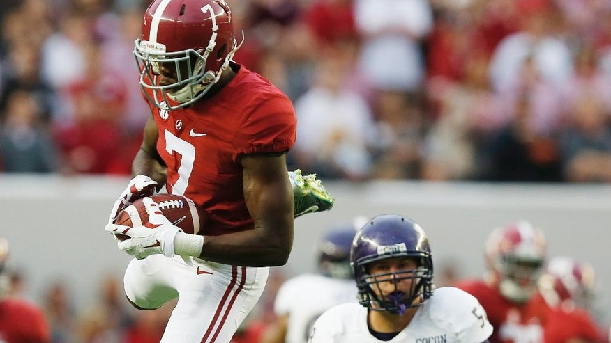 Alabama wide receiver Cam Sims (7) catches the ball against Western Carolina linebacker Daniel Riddle (58) during the first half of an NCAA college football game, Saturday, Nov. 22, 2014, in Tuscaloosa, Ala. (AP Photo/Brynn Anderson)