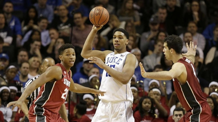 Duke's Jahlil Okafor, center, is guarded by Stanford's Anthony Brown, left, and Stefan Nastic during the first half of an NCAA college basketball game for first place in the Coaches vs. Cancer Classic, Saturday, Nov. 22, 2014, in New York. (AP Photo/Seth Weng)