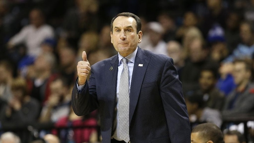 Duke coach Mike Krzyzewski gives a thumbs-up during the first half of an NCAA college basketball game against Stanford for first place in the Coaches vs. Cancer Classic, Saturday, Nov. 22, 2014, in New York. (AP Photo/Seth Weng)