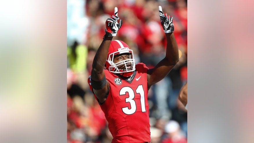 Georgia wide receiver Chris Conley (31) reacts after scoring a touchdown on a pass from quarterback Hutson Mason in the first half of an NCAA college football game against Charleston Southern, Saturday, Nov. 22, 2014, in Athens, Ga.  (AP Photo/John Bazemore)
