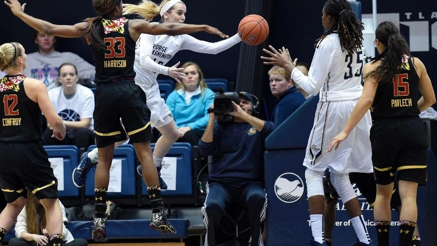 George Washington guard Shannon Cranshaw, third from right, passes the ball to Jonquel Jones (35) against Maryland forward A'Lexus Harrison (33), Chloe Pavlech (15) and Kristen Confroy (12) during the first half of an NCAA college basketball game, Saturday, Nov. 22, 2014, in Washington. (AP Photo/Nick Wass)