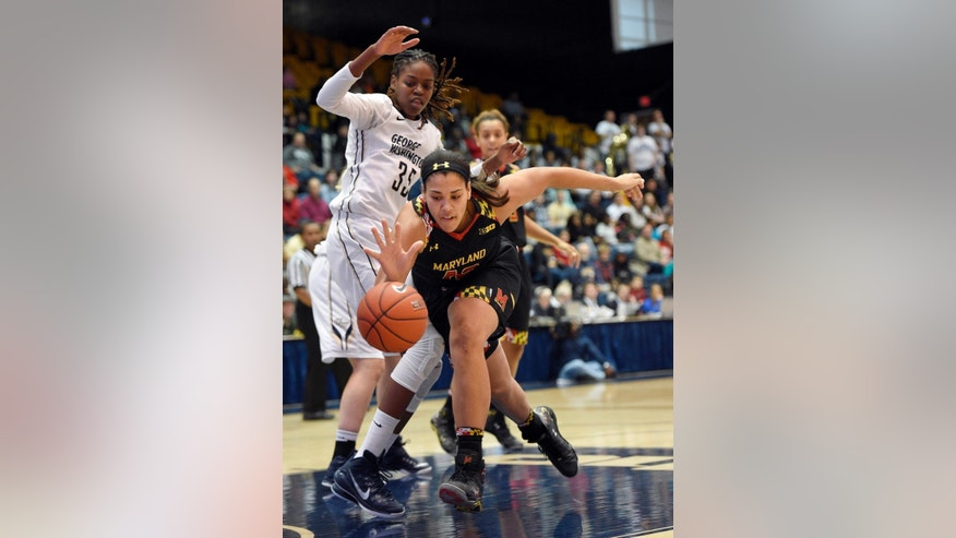 Maryland center Brionna Jones (42) chases after the ball against George Washington forward Jonquel Jones (35) during the first half of an NCAA college basketball game, Saturday, Nov. 22, 2014, in Washington. (AP Photo/Nick Wass)