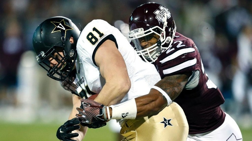 Vanderbilt tight end Steven Scheu (81) is tackled by Mississippi State linebacker Matthew Wells (22) after a short reception in the first half of an NCAA college football game Saturday, Nov. 22, 2014, in Starkville, Miss. (AP Photo/Rogelio V. Solis)