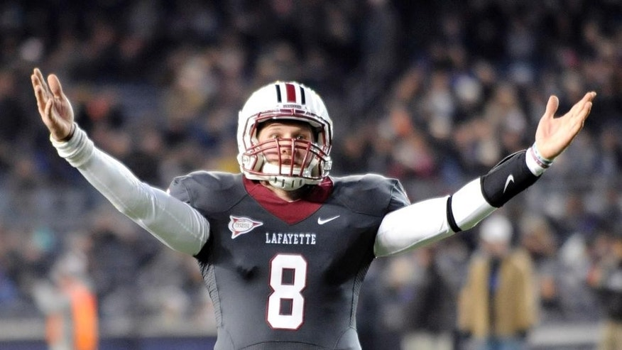 Lafayette quarterback Zach Zweizig celebrates after a touchdown during the first half of an NCAA college football game Saturday, Nov. 22, 2014, at Yankee Stadium in New York. Lehigh and Lafayette meet for the 150th time in college football's most-played and longest continuous rivalry. (AP Photo/Bill Kostroun)