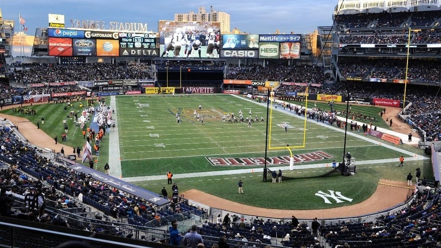 Lehigh and Lafayette play during the first half of an NCAA college football game Saturday, Nov. 22, 2014, at Yankee Stadium in New York. Lehigh and Lafayette meet for the 150th time in college football's most-played and longest continuous rivalry. (AP Photo/Bill Kostroun)