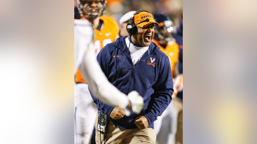 Virginia head coach Mike London reacts to a call during the first half of an NCAA college football game against Miami in Charlottesville, Va., Saturday, Nov. 22, 2014. (AP Photo/Steve Helber)