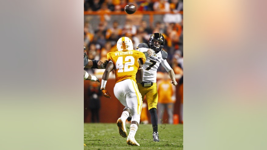 Missouri quarterback Maty Mauk (7) throws to a receiver as he's pressured by Tennessee linebacker Chris Weatherd (42) in the second half of an NCAA college football game Saturday, Nov. 22, 2014 in Knoxville, Tenn. Missouri  won 29-21. (AP Photo/Wade Payne)