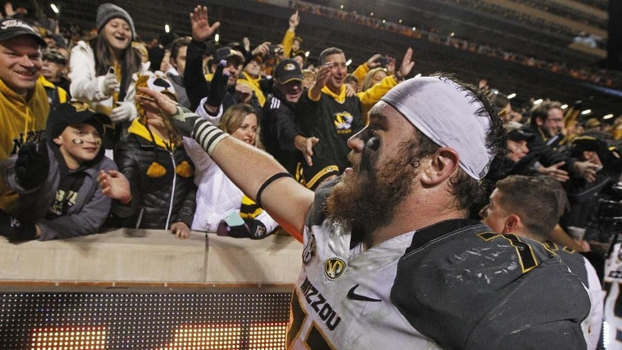 Missouri offensive lineman Evan Boehm (77) celebrates with fans after an NCAA college football game against Tennessee on Saturday, Nov. 22, 2014, in Knoxville, Tenn. Missouri won 29-21. (AP Photo/Wade Payne)