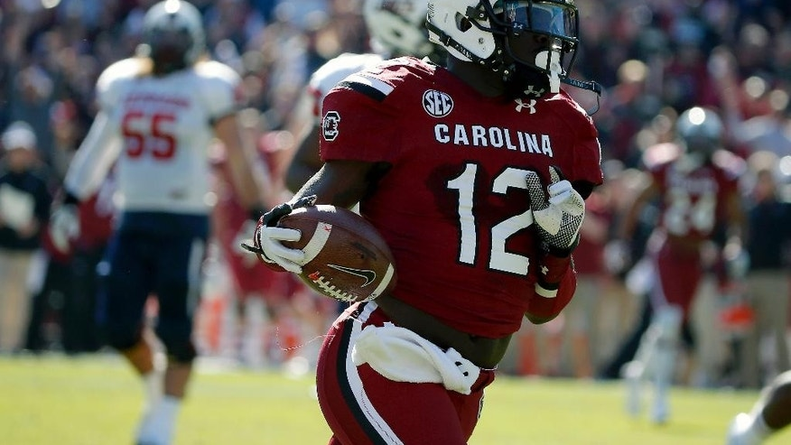 South Carolina safety Brison Williams (12) returns an interception for a touchdown during the first half of an NCAA college football game against South Alabama in Columbia, S.C., Saturday, Nov. 22, 2014. (AP Photo/Stephen B. Morton)