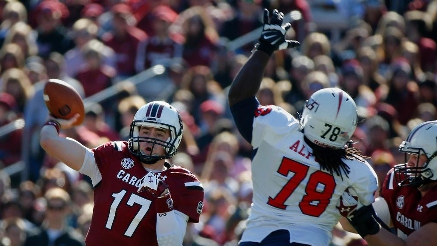 South Carolina quarterback Dylan Thompson (17) throws down field during the first half of an NCAA college football game against South Alabama in Columbia, S.C., Saturday, Nov. 22, 2014. (AP Photo/Stephen B. Morton)