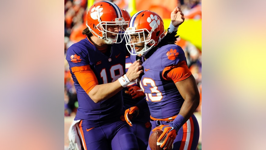 Clemson running back Tyshon Dye (23) celebrates a touchdown with teammate Cole Stoudt (18) during the first half of an NCAA college football game against Georgia State, Saturday, Nov. 22, 2014, in Clemson, S.C. (AP Photo/Rainier Ehrhardt)