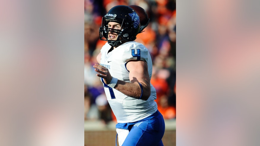Georgia State quarterback Nick Arbuckle (4) looks to throw against Clemson during the first half of an NCAA college football game, Saturday, Nov. 22, 2014, in Clemson, S.C. (AP Photo/Rainier Ehrhardt)