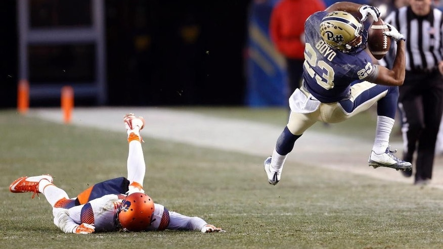 Pittsburgh Panthers wide receiver Tyler Boyd (23) makes a catch for a first down past Syracuse Orange cornerback Brandon Reddish, left, in the second quarter of an NCAA college football game, Saturday, Nov. 22, 2014, in Pittsburgh. (AP Photo/Keith Srakocic)