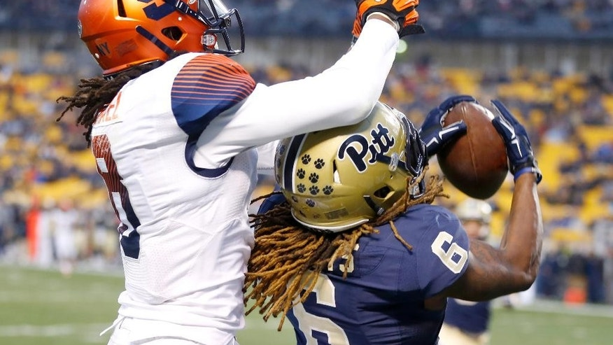 Pittsburgh Panthers defensive back Lafayette Pitts (6) intercepts a pass intended for Syracuse Orange wide receiver Steve Ishmael (8) in the first quarter of an NCAA college football game, Saturday, Nov. 22, 2014, in Pittsburgh. (AP Photo/Keith Srakocic)