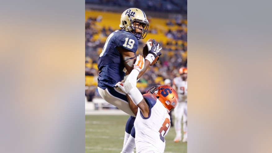 Pittsburgh wide receiver Dontez Ford (19) makes a touchdown catch over Syracuse safety Darius Kelly (8) in the second quarter of an NCA college football game, Saturday, Nov. 22, 2014, in Pittsburgh. (AP Photo/Keith Srakocic)