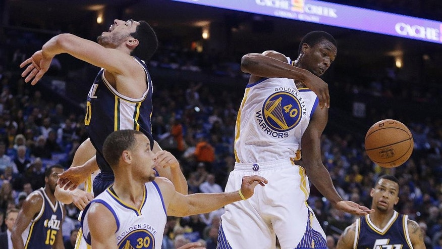 Golden State Warriors' Harrison Barnes (40) reaches for a rebound during the first half of an NBA basketball game against the Utah Jazz on Friday, Nov. 21, 2014, in Oakland, Calif. (AP Photo/Ben Margot)