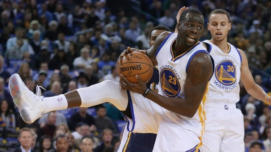 Golden State Warriors' Draymond Green (23) rebounds against the Utah Jazz during the first half of an NBA basketball game Friday, Nov. 21, 2014, in Oakland, Calif. (AP Photo/Ben Margot)