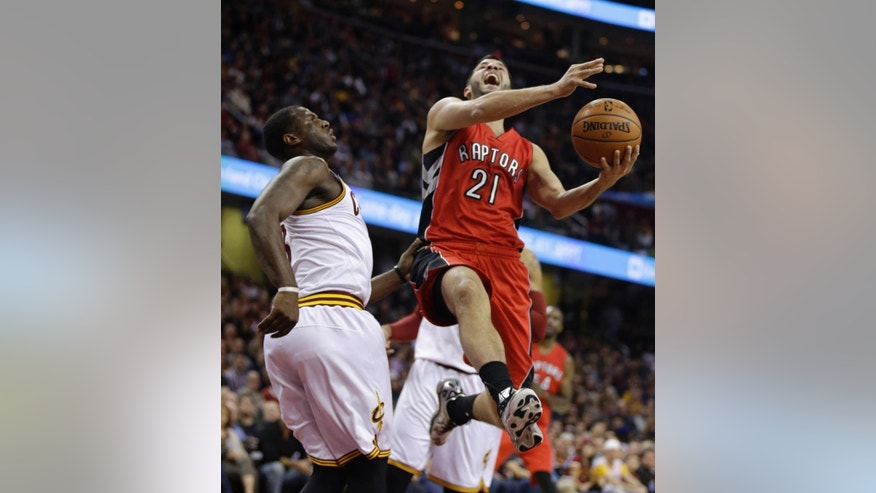 Toronto Raptors' Greivis Vasquez (21), from Venezuela, is fouled by Cleveland Cavaliers' Dion Waiters (3) during the second quarter of an NBA basketball game Saturday, Nov. 22, 2014, in Cleveland. (AP Photo/Tony Dejak)