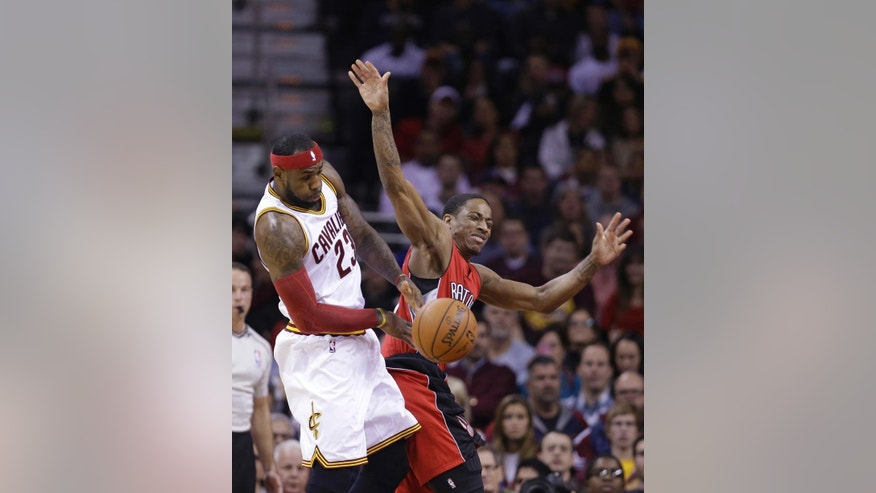Cleveland Cavaliers' LeBron James (23) steals the ball against Toronto Raptors' DeMar DeRozan (10) during the first quarter of an NBA basketball game Saturday, Nov. 22, 2014, in Cleveland. (AP Photo/Tony Dejak)