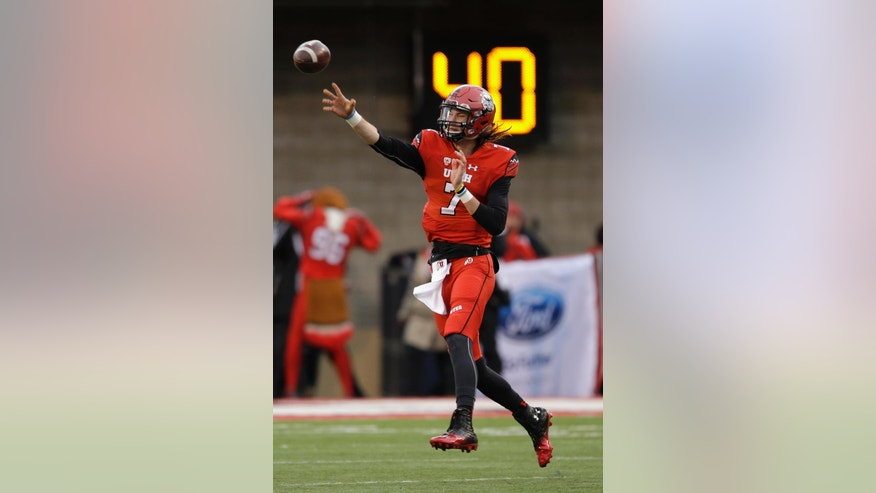Utah quarterback Travis Wilson (7) passes the ball in the first quarter of an NCAA college football game against Arizona, Saturday, Nov. 22, 2014, in Salt Lake City. (AP Photo/Rick Bowmer)