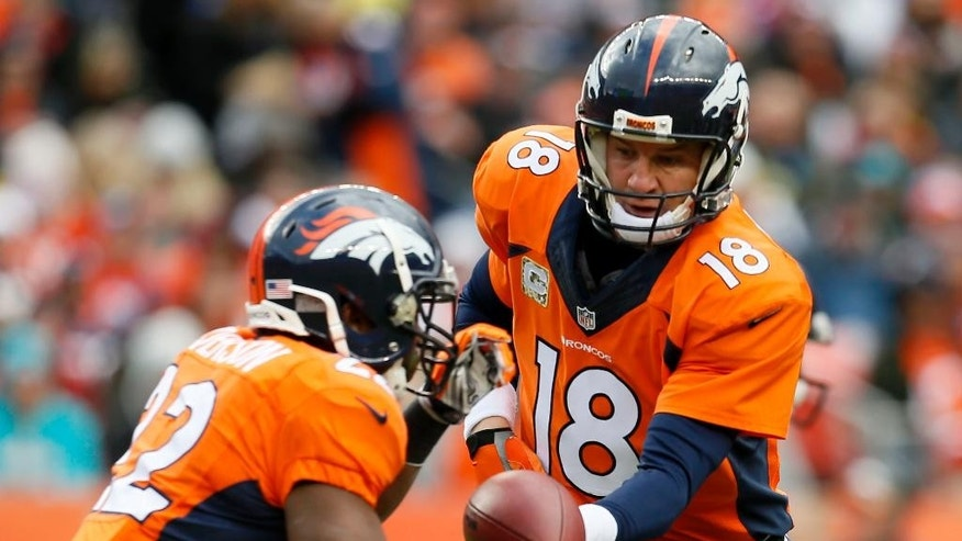 Denver Broncos quarterback Peyton Manning (18) hands off to C.J. Anderson against the Miami Dolphins during the first half of an NFL football game against the Miami Dolphins, Sunday, Nov. 23, 2014, in Denver. (AP Photo/Joe Mahoney)