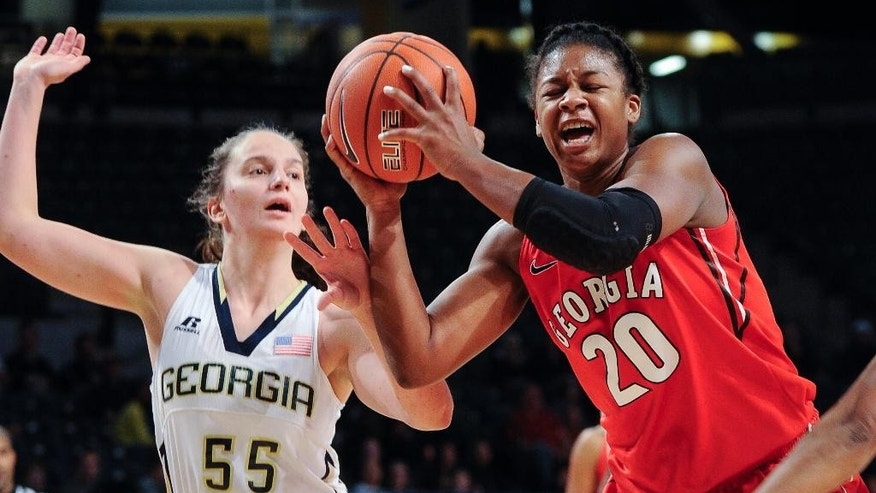 Georgia guard Shacobia Barbee (20) shoots as Georgia Tech guard Antonia Peresson (55) defends during the first half of an NCAA college basketball game, Sunday, Nov. 23, 2014, in Atlanta. (AP Photo/John Amis)