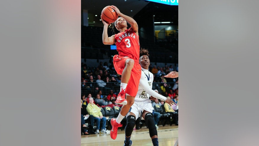 Georgia guard Tiaria Griffin (3) shoots past the defense of Georgia Tech guard Aaliyah Whiteside (2)  during the first half of an NCAA college basketball game, Sunday, Nov. 23, 2014, in Atlanta. (AP Photo/John Amis)