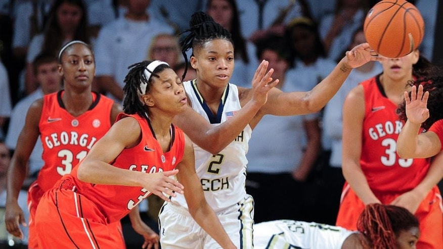 Georgia Tech forward Aaliyah Whiteside (2) passes as Georgia guard Tiaria Griffin (3) defends during the first half of an NCAA college basketball game, Sunday, Nov. 23, 2014, in Atlanta. (AP Photo/John Amis)