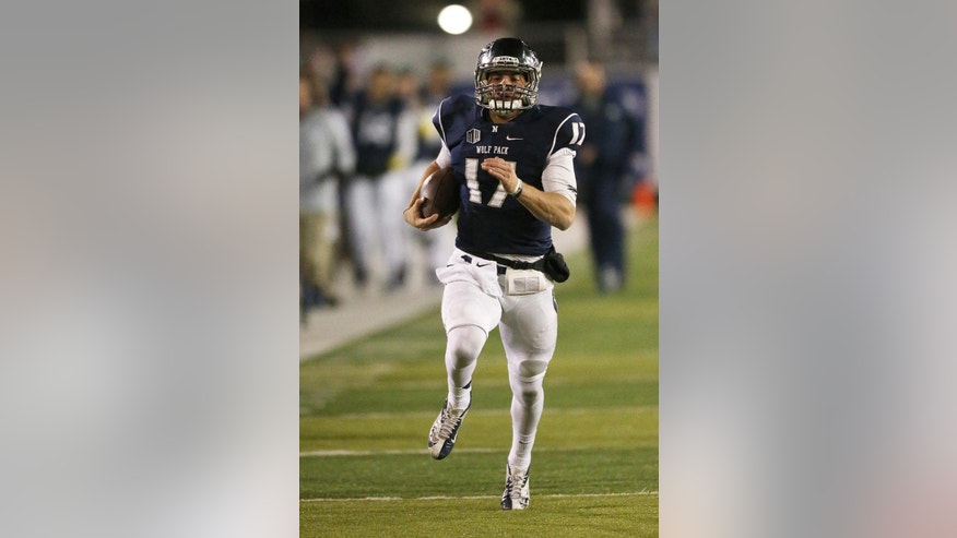 Nevada's Cody Fajardo (17) runs down the sideline to score against Fresno State during the first half of an NCAA college football game in Reno, Nev., on Saturday, Nov. 22, 2014. (AP Photo/Cathleen Allison)