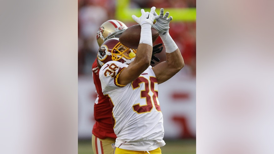 Washington Redskins cornerback Greg Ducre (38) intercepts a pass intended for San Francisco 49ers wide receiver Anquan Boldin, rear, during the third quarter of an NFL football game in Santa Clara, Calif., Sunday, Nov. 23, 2014. (AP Photo/Ben Margot)