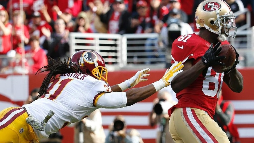 San Francisco 49ers wide receiver Anquan Boldin (81) scores on a 30-yard touchdown reception past Washington Redskins strong safety Brandon Meriweather during the first quarter of an NFL football game in Santa Clara, Calif., Sunday, Nov. 23, 2014. (AP Photo/Tony Avelar)