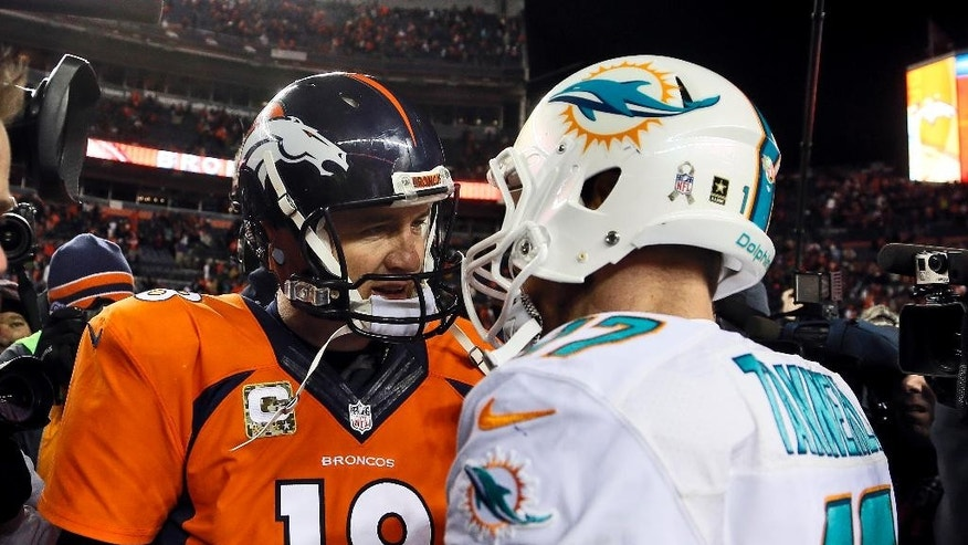 Denver Broncos quarterback Peyton Manning (18) greets Miami Dolphins quarterback Ryan Tannehill (17) after an NFL football game, Sunday, Nov. 23, 2014, in Denver. The Broncos won 39-36. (AP Photo/Joe Mahoney)