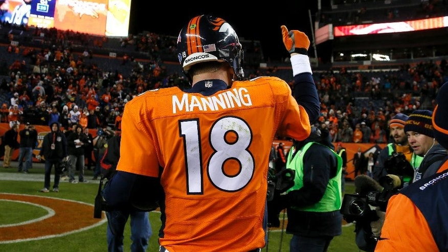 Denver Broncos quarterback Peyton Manning (18) leaves the field after an NFL football game against the Miami Dolphins, Sunday, Nov. 23, 2014, in Denver. The Broncos won 39-36. (AP Photo/Joe Mahoney)