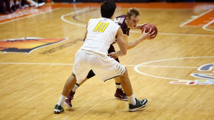 George Mason forward Marko Gujanicic (10) pressures College of Charleston guard Canyon Barry during a NCAA college basketball game in San Juan, Puerto Rico, Sunday, Nov. 23, 2014. (AP Photo/Ricardo Arduengo)